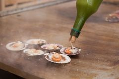 Queen scallops on the grill Stock Image