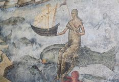 Queen of the sea. Holding a boat and riding a fish - wall painting, Voronet church (UNESCO World Heritage Site), Romania Stock Photo