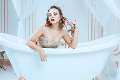 Queen sitting in the bath. Stock Photos