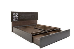 Queen sized modern bed with mattress and stylish design pattern on its head board. Queen size bed with storage compartment stock photography
