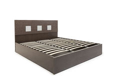 Queen sized modern bed with mattress and stylish design pattern on its head board. Queen size bed with storage compartment stock photo