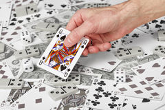 Queen of Spades in hand. The Queen of Spades in the men's hand Stock Images