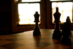 The Queen stands. Backlight shot of chess piece Stock Photos