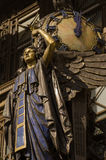 Queen of Time, Oxford Street. The landmark Queen of Time statue on public display on the facade of Selfridges since 1931.  The bronze was sculpted by Gilbert Royalty Free Stock Photo