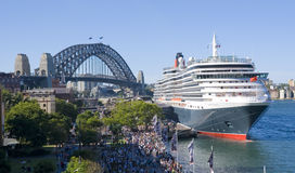 Queen Victoria Cruise Ship Sydney Harbor. Cruise ship Queen Victoria with Sydney Harbour Bridge in Background. Two massive icons together Royalty Free Stock Photo