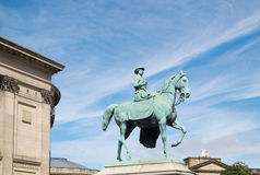 Queen Victoria on a horse, statue in Liverpool. Statue of Queen Victoria sidesaddle on a horse in Liverpool, Merseyside Stock Images