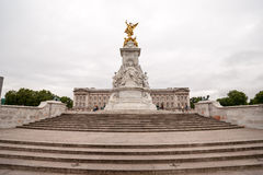 Queen Victoria Memorial in front of Buckingham Palace at London. On cloudy day Stock Photography