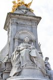 Queen Victoria Memorial in front of the Buckingham Palace, London, United Kingdom. The monument was unveiled in 1911, made of 2,300 tons of gleaming white Royalty Free Stock Photo