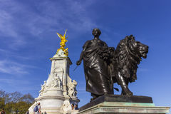 Queen Victoria Memorial in The Mall in London. London, England - 9th of April 2017: Tourists around the Memorial of Quen Victoria in The Mall street in front of Royalty Free Stock Photo