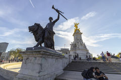 Queen Victoria Memorial in The Mall in London. London, England - 9th of April 2017: Tourists around the Memorial of Quen Victoria in The Mall street in front of Stock Photography