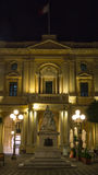 Queen Victoria statue, Bibliotheca building by night Republic Square Valletta Malta by night Stock Photo