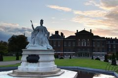 Queen Victoria statue in front of Kensington Palace London. Europe and sunset sky with clouds Royalty Free Stock Photography