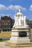 Queen Victoria Statue at Kensington Palace in London. The impressive statue of Queen Victoria situated outside Kensington Palace in London Royalty Free Stock Image