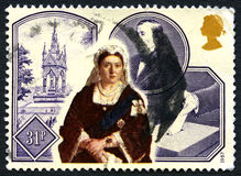 Queen Victoria UK Postage Stamp. UNITED KINGDOM - CIRCA 1987: A used postage stamo from the UK, commemorating 150th Anniversary of Queen Victoria`s Accession Stock Photo