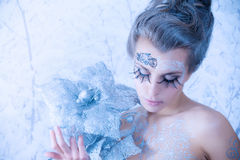 Queen of winte. Blue toning. Beautiful sexy, glamorous girl with drawings on the body in an image of the queen of winter. Blue toning royalty free stock photo