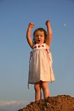 Queen of the World. A little girl playing queen of the mountain Stock Photos