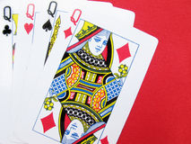 Queens. Four queens of playing card isolated on red background stock image