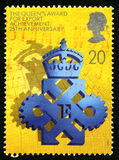 The Queens Award for Export Achievement UK Postage Stamp. GREAT BRITAIN - CIRCA 1990: A used postage stamp from the UK, celebrating the 25th Anniversary of the Stock Image