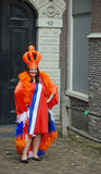 Queens day. Young woman dressed up to celebrate , Amsterdam, Netherlands Royalty Free Stock Photo