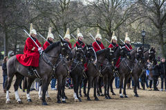 The Queens lifeguards on horseback inside Horse Guards Parade in Royalty Free Stock Photo