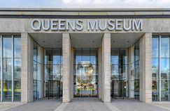Queens Museum - New York City. Flushing, New York - April 21, 2018: Front entrance of the Queens Art Museum in Fushing Meadows Corona Park, Queens, New York royalty free stock image