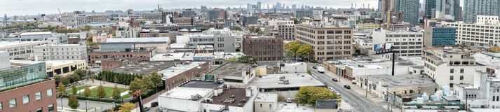 QUEENS, NEW YORK - OCTOBER 24, 2015: Panoramic view of Queens bu. Ildings. Queens is the easternmost and largest in area of the five boroughs of New York City stock image
