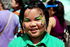 Queens, NY: Little Girl with Painted Face. QUEENS, NY:  A little girl with beautiful face paintings at the annual Hong Kong Dragon Boat Festival in Flushing Royalty Free Stock Photography