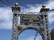 Queens Park Bridge in Chester UK. Detail with plaque of Queens Park Suspension Bridge over the River Dee in Chester Cheshire UK Stock Photography