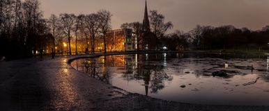 Queens Park Glasgow at night. A large Panoramic night shot of a pond and a church in a park in the south side of glasgow stock photography