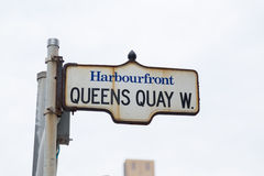 Queens Quay in Toronto. TORONTO, CANADA - 10TH MAY 2015: A sign for Queens Quay West in Toronto in the Harbourfront District Stock Images