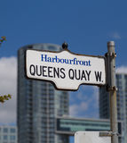 Queens Quay West in Toronto. TORONTO, CANADA - 19TH MAY 2015: A sign for Queens Quay West in Toronto in the Harbourfront District royalty free stock image