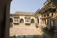 Queens`s bath, Interior pillared corridors and projecting balconies, Hampi, Karnataka India. Queens`s bath, Interior pillared corridors and projecting balconies stock image