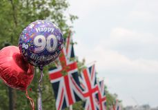 Queens 90th Birhday 2016 balloon s and Union Jack flags copy space Stock Images