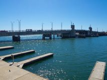 The Queens Wharf with the view of Birkenhead Bridge across port Adelaide river in blue sky day. Queens Wharf with the view of Birkenhead Bridge across port stock photos
