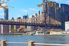 Queensboro Bridge, East River and Manhattan buildings. Stock Photo