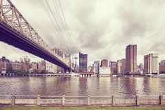 Queensboro Bridge and Manhattan seen from Roosevelt Island, NYC. Retro toned Queensboro Bridge and Manhattan seen from Roosevelt Island, New York, USA stock image