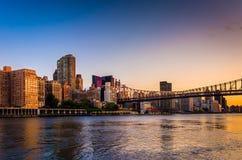 The Queensboro Bridge and Manhattan skyline at sunrise, seen fro Stock Photos