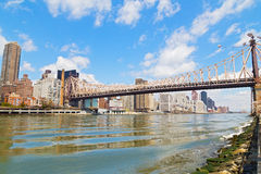 Queensboro Bridge over East River with view on Manhattan. Stock Photography