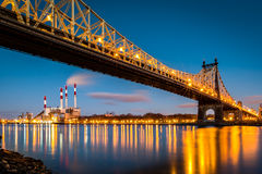 Queensboro bridge and Ravenswood station Royalty Free Stock Photo