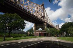 Queensboro bridge and the street at the park Royalty Free Stock Images