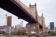 Queensborough Bridge in Midtown Manhattan with New York City skyline over East River Stock Photo