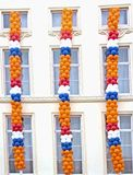Queensday decoration. On a facade in Amsterdam the Netherlands Royalty Free Stock Photo
