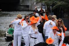 Queensdayvieringen in Amsterdam stock foto