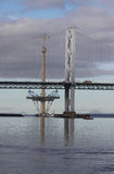 Queensferry Crossing and Forth Road Bridge. Towers of Queensferry Crossing and Forth Road Bridge Scotland Royalty Free Stock Images