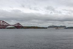 Forth Bridge near Edinburgh with luxury cruise ship Royal Princess royalty free stock image