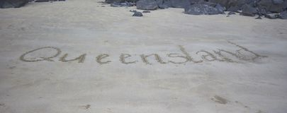 Queensland που γράφεται στην άμμο στοκ φωτογραφία με δικαίωμα ελεύθερης χρήσης