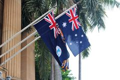 Queensland and Australia flag. On a house wall in central Brisbane stock images