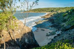 Queensland coast in the summer, beach in a cove royalty free stock photography