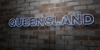 QUEENSLAND - Glowing Neon Sign on stonework wall - 3D rendered royalty free stock illustration. Can be used for online banner ads and direct mailers Royalty Free Stock Photography