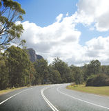 Queensland, highway. Highway under blue sky, surrounding by trees Royalty Free Stock Images
